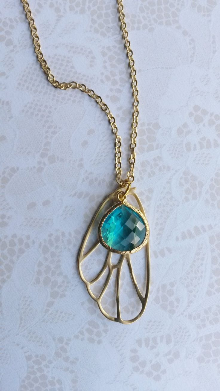 Butterfly Dreams necklace.    Stunning filigree butterfly wing with faceted aqua gem by NixieNooDesigns on Etsy