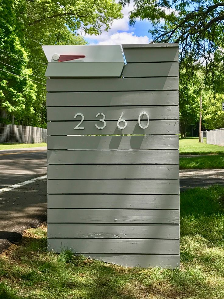 Modbox On A Slat Wood Wall Modern Mailbox Mailbox Design