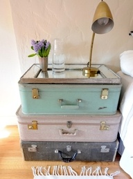 vintage suitcases + beveled mirror to create guestroom nightstand