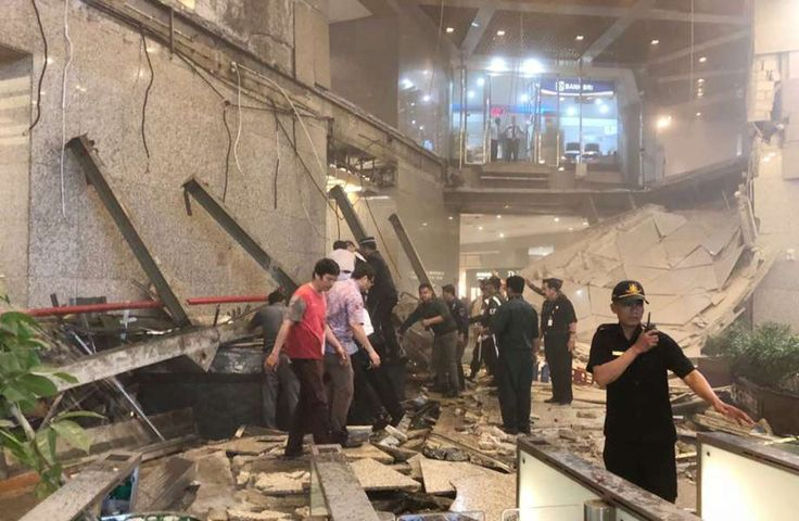 Jakarta tower hurts nearly 80   Indonesian security stand near the ruin of a structure inside the Jakarta Stock Exchange tower in Jakarta, Indonesia, Monday, Jan. 15, 2018. A structure inside the Jakarta Stock Exchange tower collapsed Monday, injuring at least several people and forcing a chaotic evacuation. Photo: AP / Copyright 2018 The Associated Press. All rights reserved.