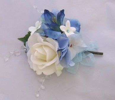 Mom's and Grandma's - Coral rose with blue hydrangea and stephanotis.. we can make this a little bigger.. with 2 or 3 roses