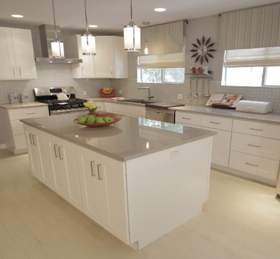 Pendant light fixtures over the island  HGTVs Property Brothers white and grey