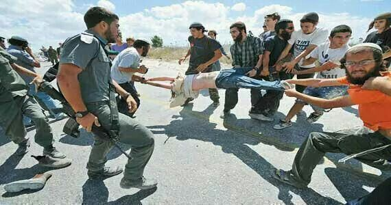 The torturing of a Palestinian child by Israeli Settlers. Passively observed by Israeli Police.