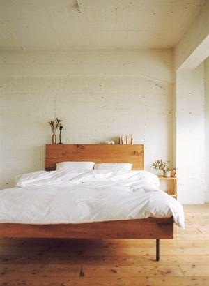 Wood and white makes a lovely, warm minimalist bedroom.