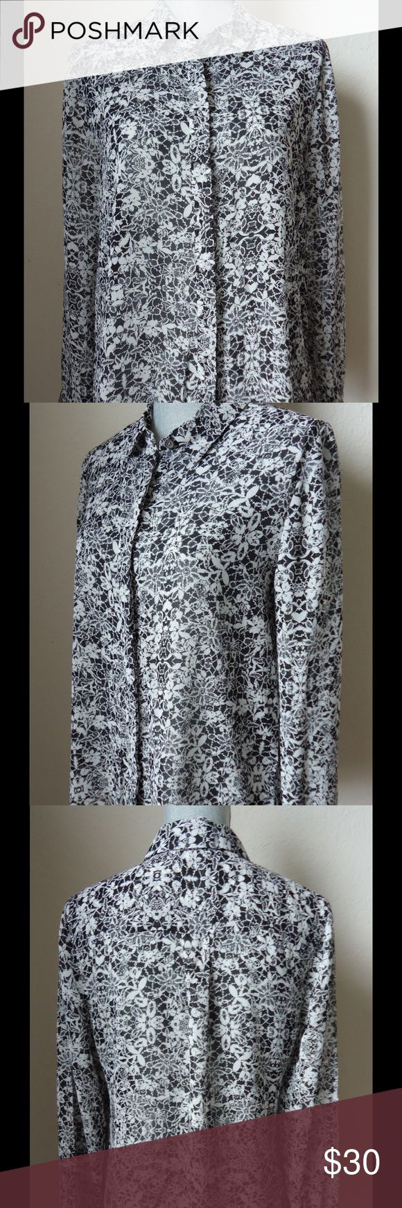 Vince Camuto Black and White Floral Blouse Long sleeve Blouse, semi sheer. Black and white floral pattern. In excellent used condition. 100% polyester. Measures approximately 18 inches from arm pit to arm pit.  Measures approximately 27 inches from shoulder to hem. Vince Camuto Tops Blouses