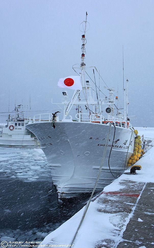 Boat at Lake Rausu, Hokkaido, during a snow storm.
