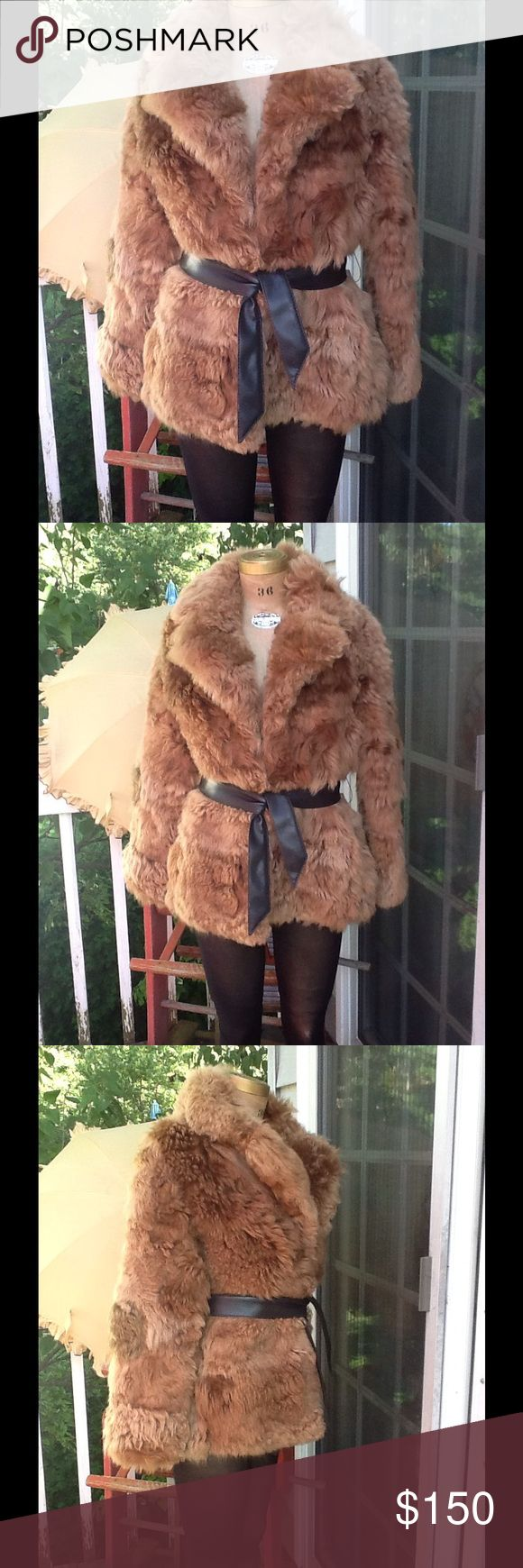 "Vtg Lamb Fur Jacket/Coat...Fantabulous!!! Love this awesome Vtg Lamb Fur Jacket/Coat...its in a brown lamb fur (very Plush) shawl collar with faux leather brown belt(that's the only closure) it's fully lined with some fading but does not hinder use and can't be seen, it's a sz S but could fit a M made in Korea....the only issue this has is a bit of a musty smell,I've gotten most of the smell out it was much much worse then it is now I just keep it hung outside, L:27"", B:40 laying flat…"