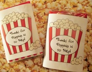 """Volunteer gifts - microwave popcorn with the label """"thanks for popping in to help""""  Also packs of Extra gum with label """"thanks for going the extra mile to volunteer"""""""