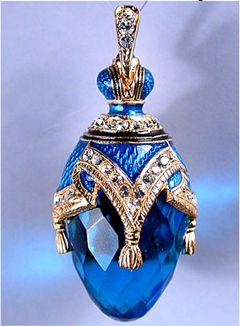 Fabergè style Russian made egg pendant blue enamel silver and gold plating with the tassel decorations and Swarovski crystals.