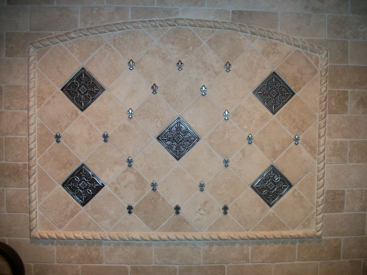Marble Backsplash Accented With Daltile Fluer De Lis Accents In Pewter