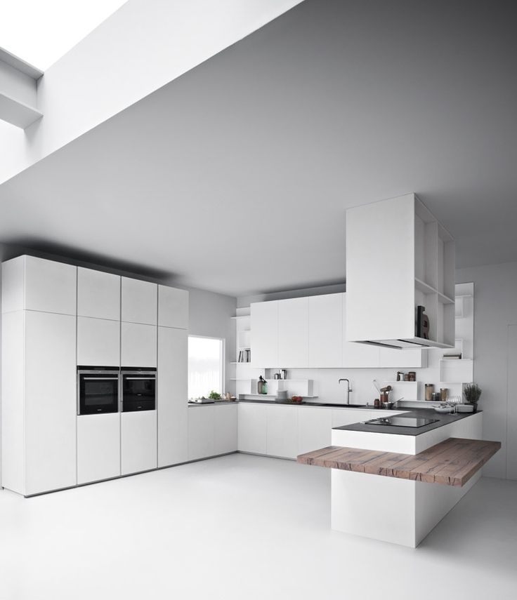 Zamperei - Line K kitchen in ice cement resin and white lacquer.