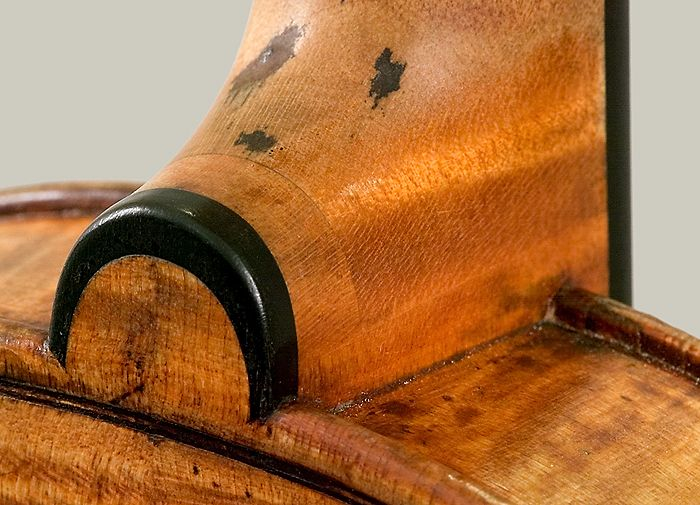 """The """"Harrison"""" (1693) is one of only a handful of Stradivari violins that survive with its original neck, blocked out at the base of the neck, with oxidation showing from the three original nails {treble bass side}"""