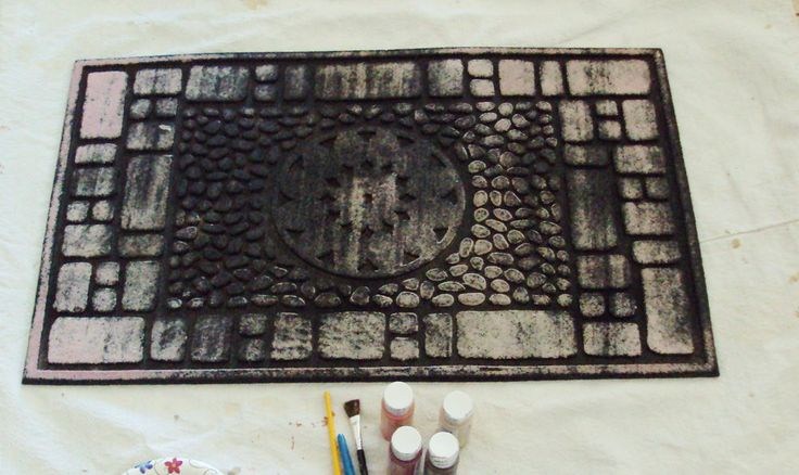 """I saw this idea on Pinterest where someone used a new rubber mat and painted color blocks on it to mimic a more expensive designer mat and I thought """"hey, my ou…"""