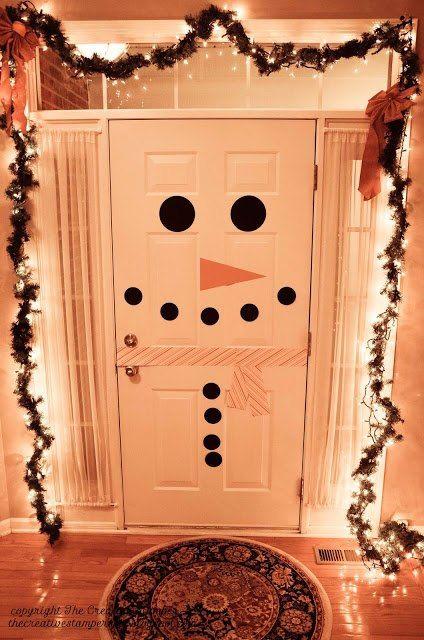sneeuwpop op de deur