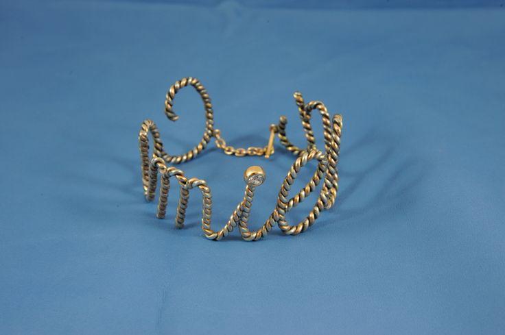 Bracciale nome realizzato con un filo di argento e un filo di oro rosa intrecciati! INTRigante!