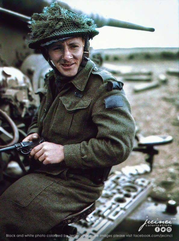 Cpl Earl McAllister, of Hamilton, Ontario, Member of North Shore Regiment, 8th Brigade, 3rd Cdn Inf. Division, poses on a captured knocked-out German 88mm battery gun. He is holding a Luger P08 pistol possibly liberated from one of the captives. Has to his credit the capture of 160 Germans at St Lambert-sur-Dives.France 1944. Colorized by Jecinci