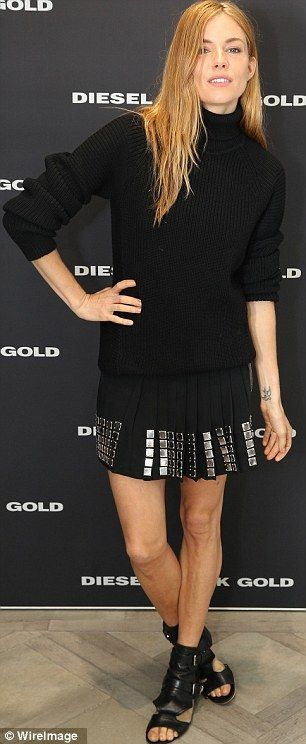 Back in black: Sienna Miller, 32, donned a rather dark ensemble as she attended  the Diese...