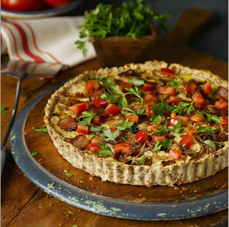 All-Bran™ Onion, Bacon and Swiss Tart Recipe - Filled with a mouth-watering combination of flavours, this savoury tart makes a delightful dinner when served with a side salad. #AllBran #Bacon #Tart #Recipe #SideDish #Fibre