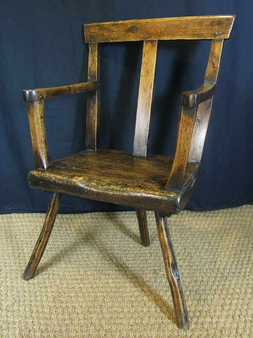 A stunning mid 18th century North Wales stick chair. This chair is amongst the best examples available, in one of the rarest styles found in Welsh stick chairs. Being constructed of oak with a deal seat standing on three stick legs.