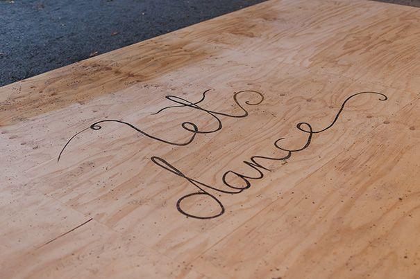 ANNA + GEORGE - Wood-burned words on plywood dance floor.