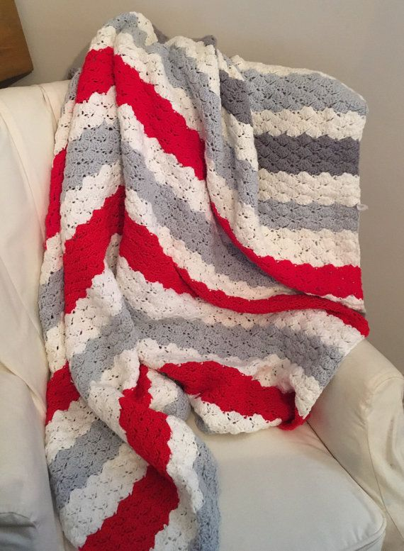 Vintage Baby Nursery Blanket | Crochet Baby Blanket | Vintage Throw Blanket | Afghan Boys Girls Blanket | Striped Blanket | Minimalist Decor CONDITION: Vintage Excellent DIMENSIONS: 77.5 x 60.8 FEATURES: Handmade Vintage Item: beautiful trending color pallet with light gray, white, and red - perfect for a gender neutral room (maybe you have two kids sharing a room - this is a great way to not go to girlie or boyish). Scalloped edge along side with red stripes. This could also serve as a…
