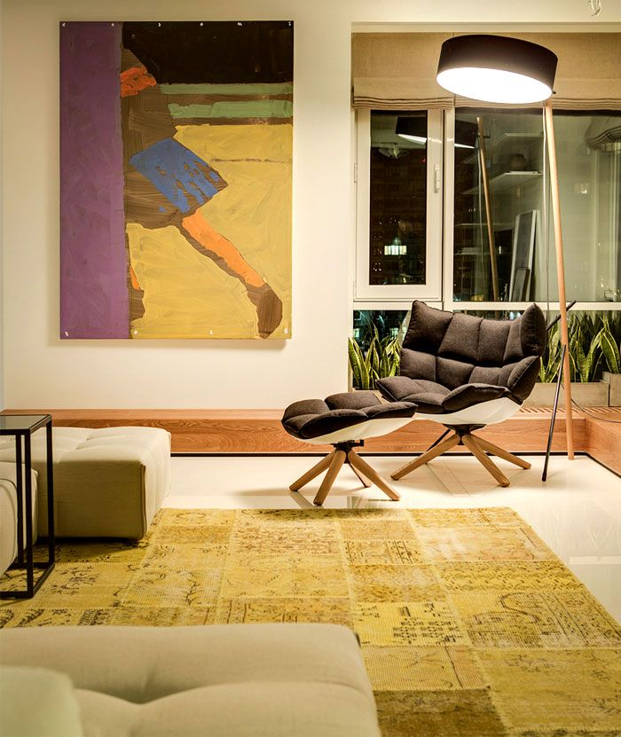 Moscow Apartment Created for a Young Family artistic yellow rug