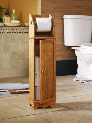 Pequeño estante para papel higiénico. De madera. Buena idea.
