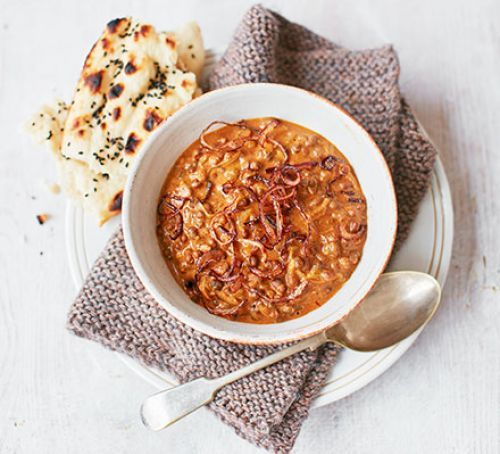 Creamy black dhal with crispy onions: The key to achieving an authentic finish to this slow cooker curry is sourcing black urid beans and ghee, but yellow split peas and butter would work too. Top with crispy fried onions, either from a pot or homemade, and your favourite curry sundries.
