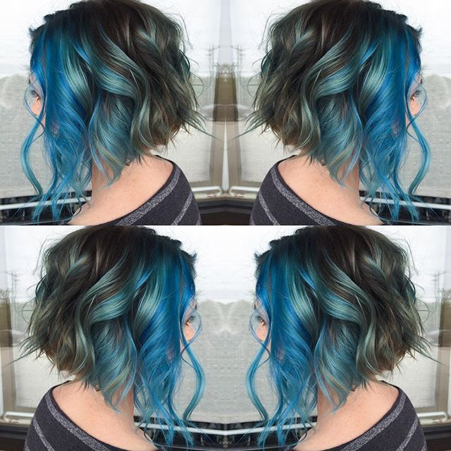 Curly a-line curly bob haircut decorated with blue hair painting Artist credit to come! hotonbeauty.com