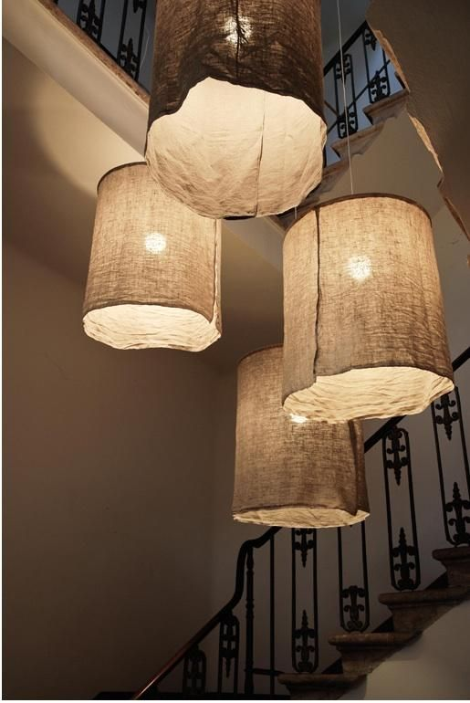 DIY linen lampshades lit in hallway by Oggetti in Italy