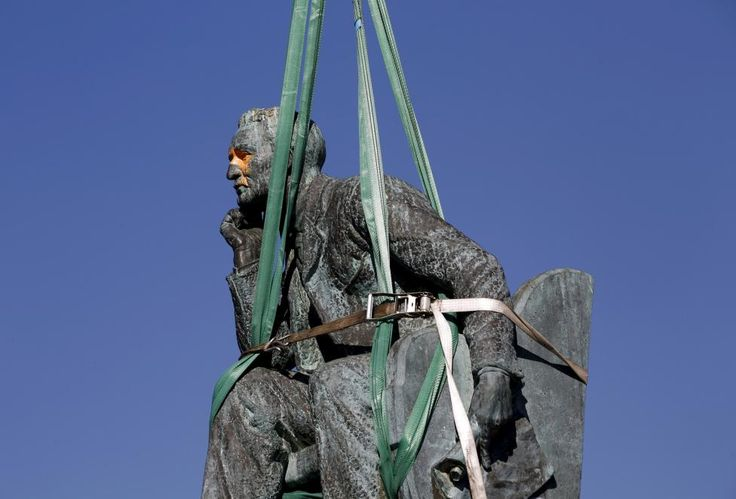 The statue of Cecil John Rhodes is bound by straps as it awaits removal from the University of Cape Town (UCT), April 9, 2015. UCT's Council voted on Wednesday to remove of the statue of the former Cape Colony governor, after protests by students. REUTERS/Mike Hutchings