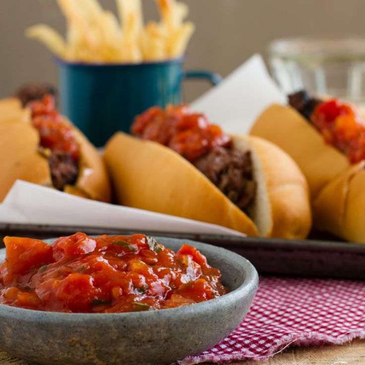 South African style Gourmet Boerewors Rolls with Tomato Braai Relish. The best hot dog and tomato sauce recipe you will ever try.