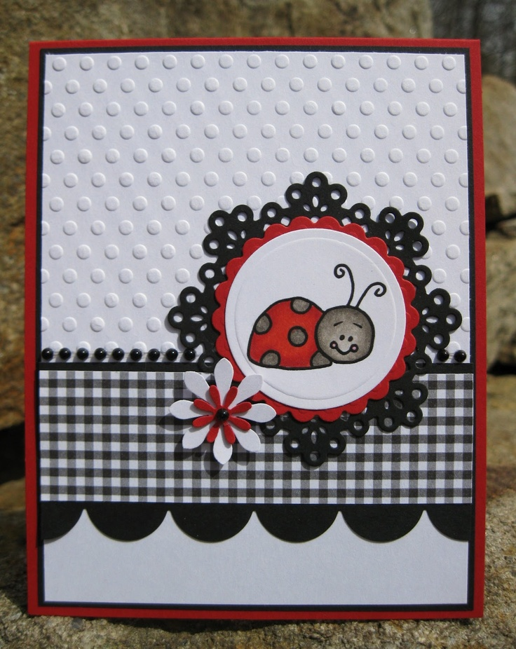 card in black and white with a pop of red...cute ladybug...lacy die-cut circle...black gingham print...embossed dots...