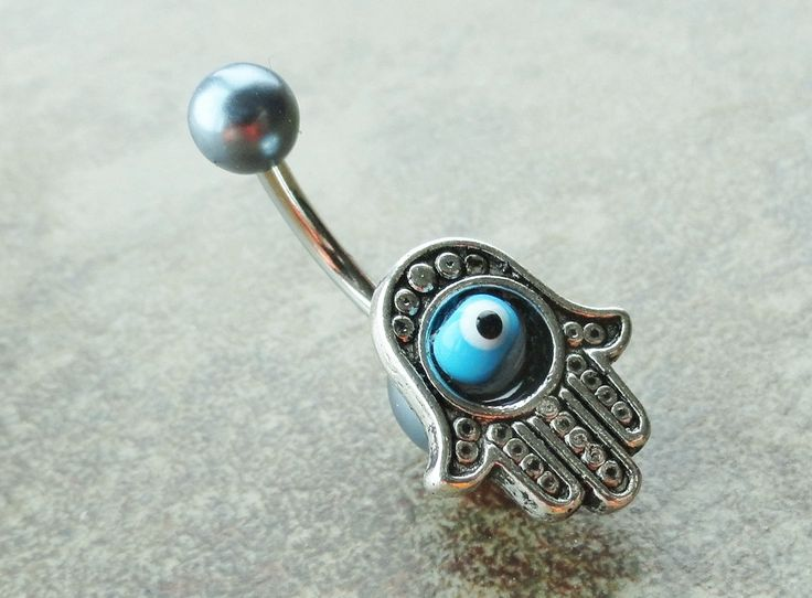 Hamsa Hand Belly Button Ring Evil Eye Belly Jewelry. $15.00, via Etsy.