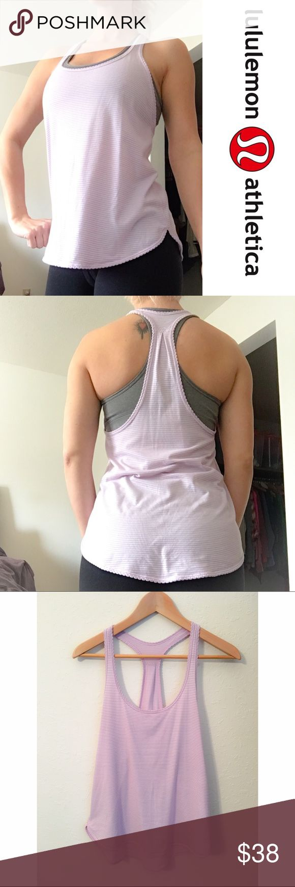 🌸Lululemon Lilac Racerback Tank🌸 A light airy comfortable fit. I have removed the inside label but it's a size 4. Well worn but no defects to it. I also have this same tank for sale in my closet in a mint color. I'm only looking to sell at this time so sorry but no trades. My listing price is firm on this particular item unless bundled for a bundle discount. lululemon athletica Tops Tank Tops