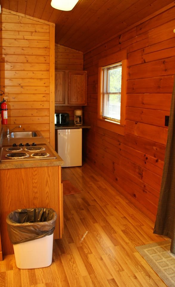 Duplex Log Cabin has a cook-top, dorm size refrigerator, a sink, microwave oven, and a coffee-maker with coffee-filters @missy byrne Point Marina & Resort Cadiz,KY. #BarkleyLake #LogCabin #Condos