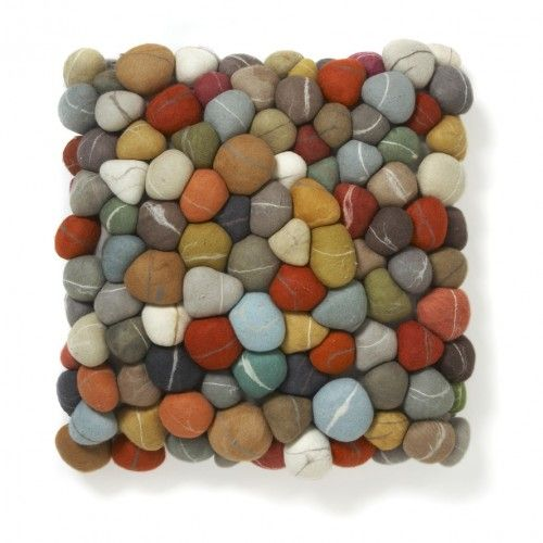 Unique with lots of charm, this colourful Pebble Pillow adds texture and loads of visual interest to your seated areas. Made from surprisingly realistic felt rocks this item was designed by internationally acclaimed designer Ronel Jordaan in South Africa. Rocks are made from felt, pillow is down filled with North American approved down. Features an invisible zipper in the pillow case.