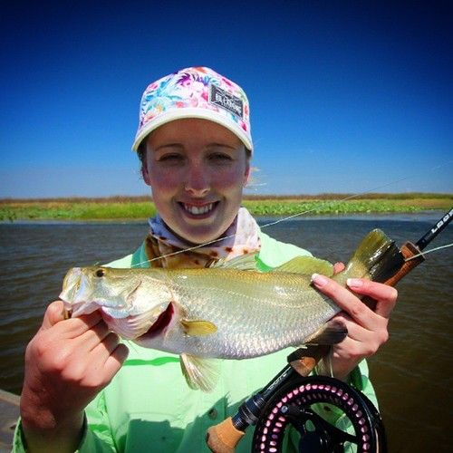 Flyjunkie Rebecca Buckley with her first ever fish on the fly #flyjunkies #barra #looplife