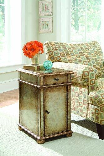This is a sophisticated transitional chest with an upscale gold/silver metallic paint that is reverse painted on mirror. It has one drawer and one door with one shelf and is finished on all four sides with bun feet.