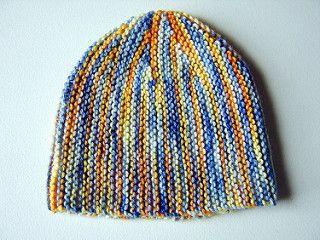 """""""This little beanie is knit flat and sideways. It's all garter stitch and an easy way to try out short rows. Very satisfying knitting as you're always decreasing and there are lots of milestones to make you feel like you're making progress."""""""