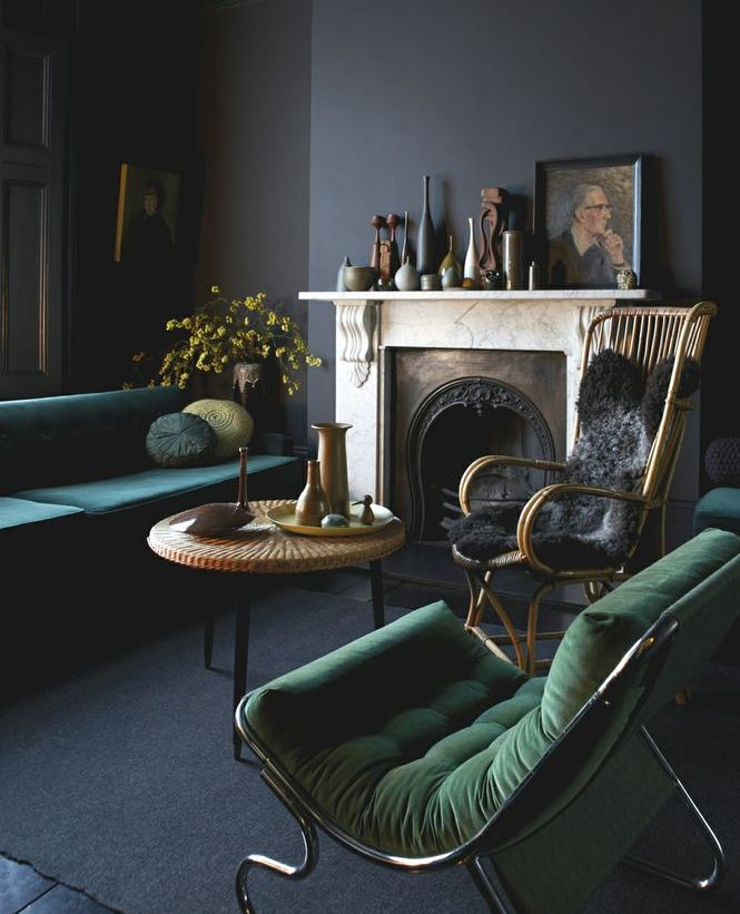 black walls and emerald green sofas