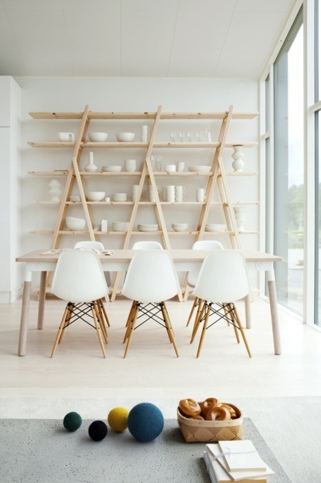 Great way to recycle ladders into shelving | white plastic herman miller eames chairs with wooden legs | light grey, white and light wood neutral tones