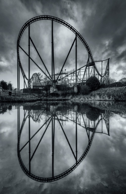 Roller coaster reflections in the pond at the abandoned Camelot Theme Park