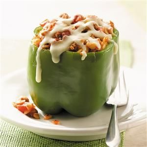 Orzo-Stuffed Peppers Recipe -Packed with orzo, Italian sausage and summer flavors, these stuffed peppers make a fun, fast-fixing meal. Get colorful with green, orange, red or yellow peppers. Use more or less pepper flakes to adjust the level of heat to your liking! —Kelly Evans, Kalamazoo, Michigan