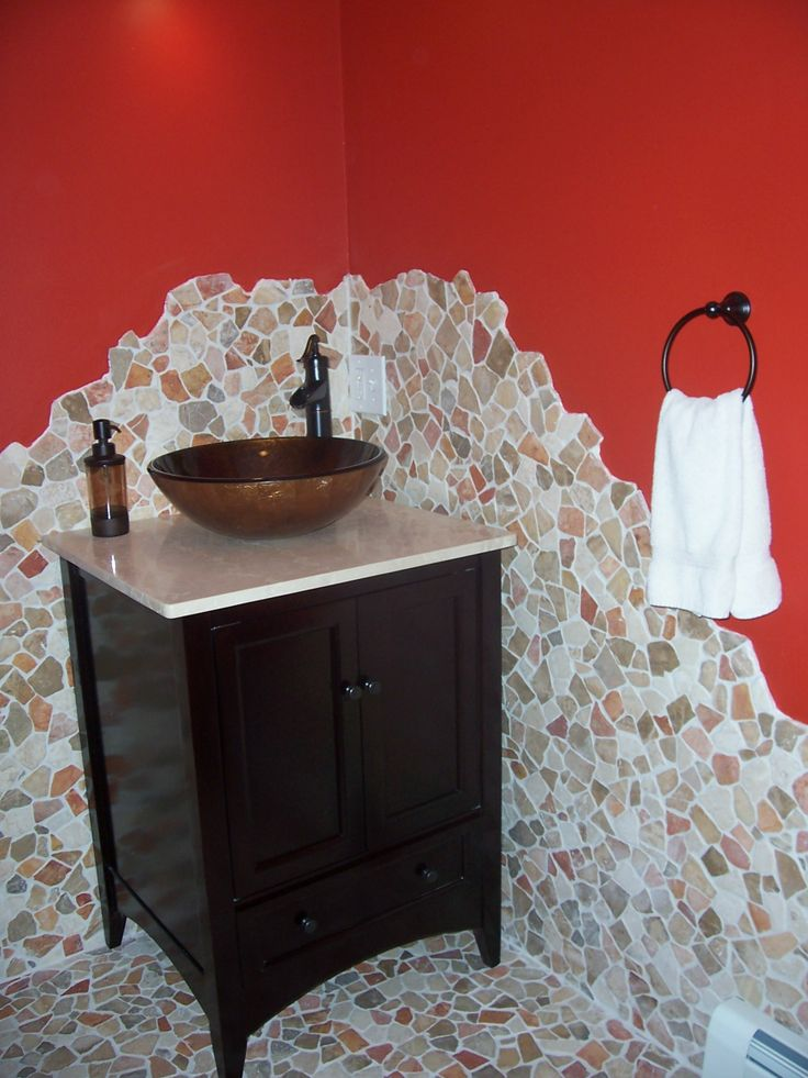The use of broken stone tile on the floor and up along the walls, gives a Tuscan look to this bathroom.