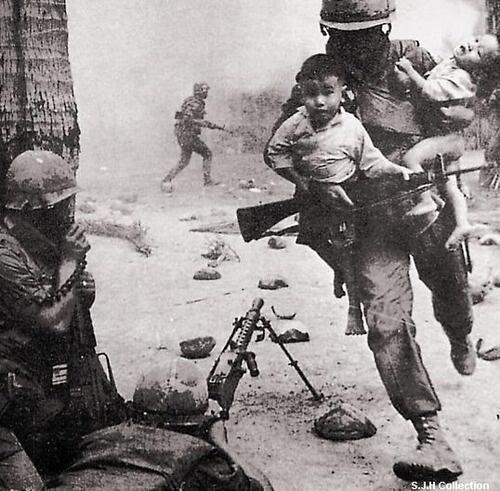 Twitter / HistoryInPics: A soldier rescuing Vietnamese children