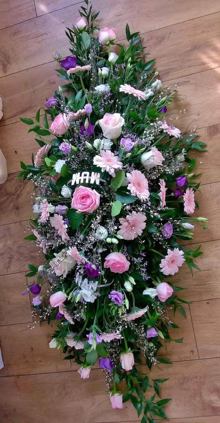 pink rose and germini coffin spray