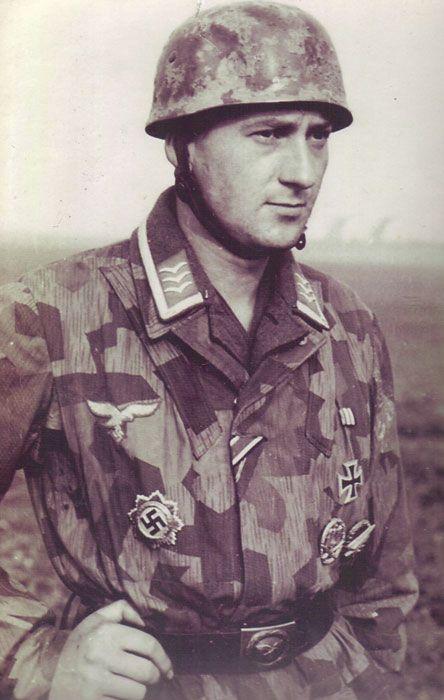 A Fallschirmjäger Feldwebel with Fallschirmschützenabzeichen (Para jump qualification jump badge), Eisen Kreuz 1st and 2nd class, Allgemeines Sturmabzeichen (General Assault Badge in gold), Ritterkreuz des Kreigsdienstkreuz(War Merit Badge) ribbon...