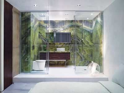 Green Modern Bathroom. In this master bedroom, the elevated bathroom is outfitted in Irish moss marble.