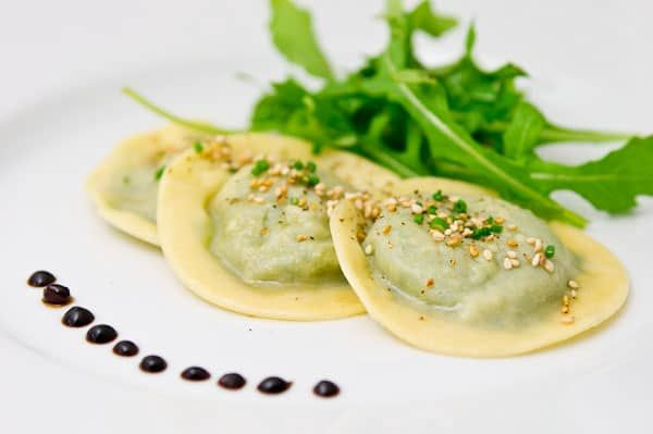 These Asian inspired raviolis are filled with ricotta, arugula, shiitake mushrooms, tahini and water chestnuts. Creamy, nutty, peppery and crispy!